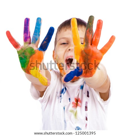 Little boy with hands painted in colorful paints ready for hand prints over white background - stock photo