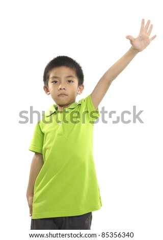 little boy with hands raised - stock photo