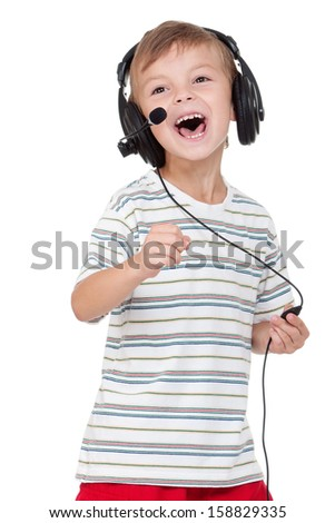 Little boy with headphones on white background - stock photo