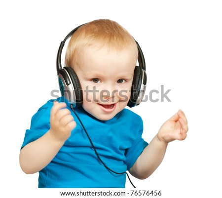 Little boy with headphones over white background