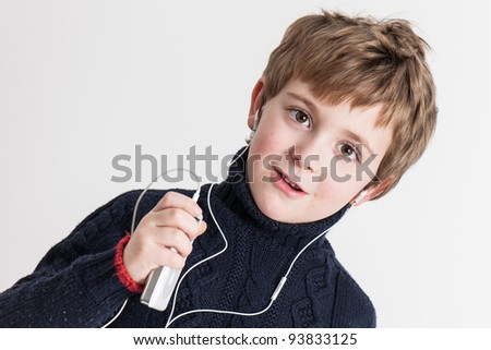 Little Boy with headset and a Music Player
