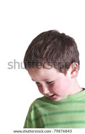 Little boy with his attention towards the floor isolated on white. - stock photo