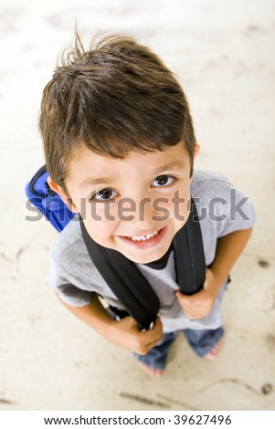 Little boy with his book bag - stock photo