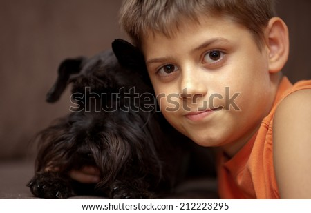 Little boy with his dog Miniature schnauzer outdoors. Close up - stock photo