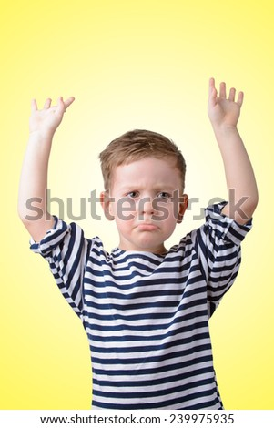 little boy with his hands raised offended - stock photo
