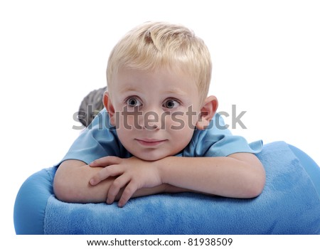 little boy with his head resting on his arms. Isolated on white background - stock photo