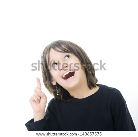 Little boy with idea showing finger upward - stock photo