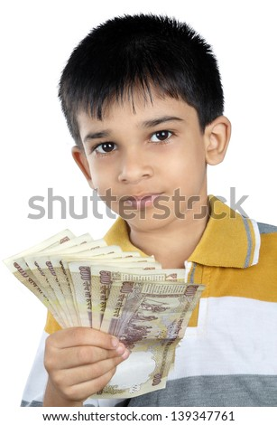 Little Boy with Indian Rupee - stock photo
