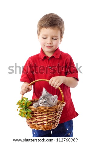 Little boy with kitten in basket, isolated on white - stock photo