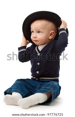 Little boy with large black hat