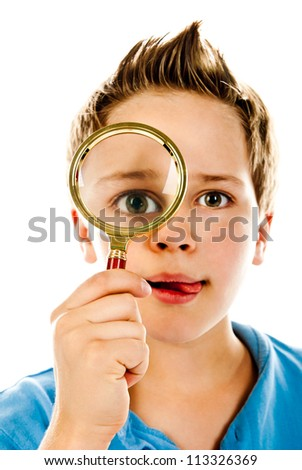 little boy with magnifier on a white background - stock photo