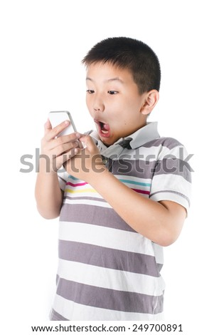 little boy with  mobile phone in hand isolated on white background. - stock photo