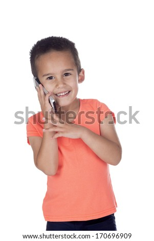 little boy with orange shirt and short brown hair posing in studio on a white background talking on a mobile phone