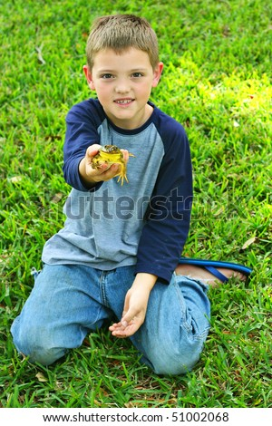little boy with pet frog