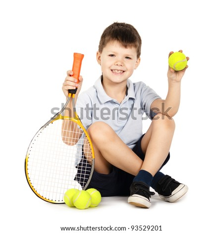 little boy with racket and balls - stock photo