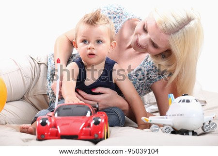 Little boy with radio-controlled car - stock photo