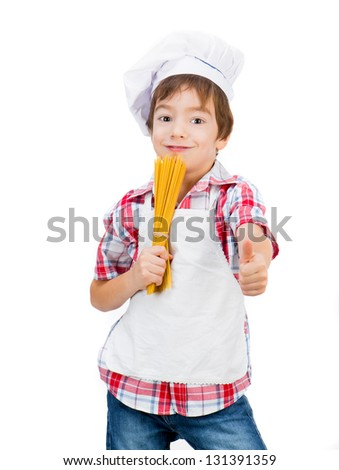 little boy with raw spaghetti with thumbs up - stock photo