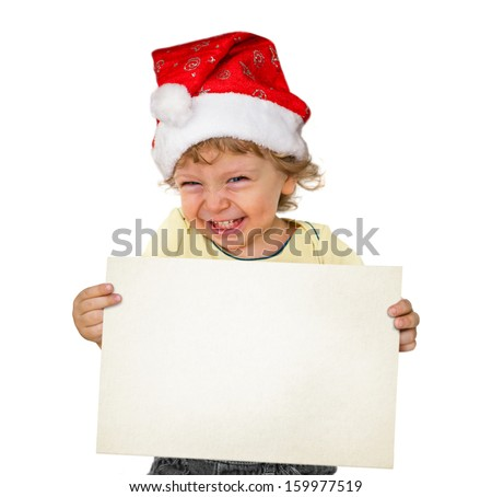 Little boy with Santa hat holding a white board  - stock photo