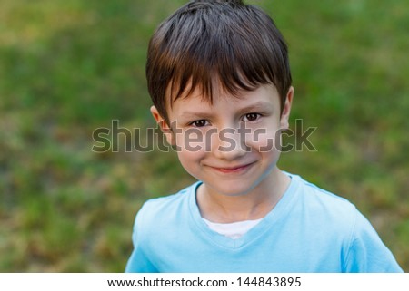 Little boy with smiley face, outdoor