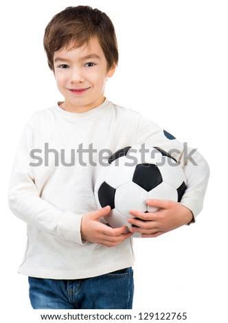 Little boy with soccer ball isolated on white - stock photo