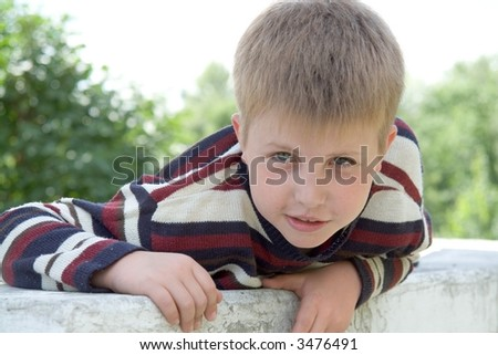 little boy with summer park at background