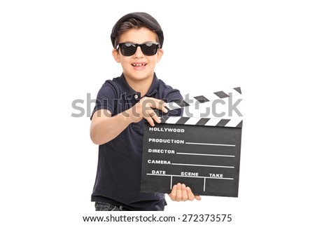 Little boy with sunglasses and a black beret having fun with a movie clapperboard isolated on white background - stock photo