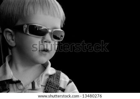Little boy with sunglasses, copy-space cute two-year old - stock photo