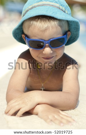 little boy with sunglasses smile - stock photo
