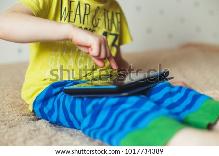 Little boy with tablet. Selective focus on child finger