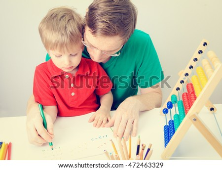 little boy with teacher learning math, early education