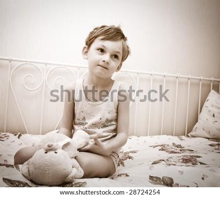 Little boy with teddy - stock photo