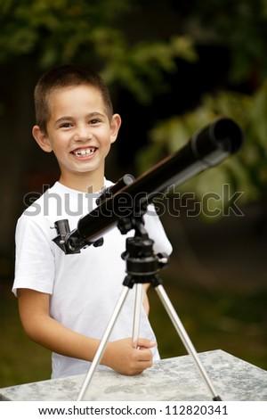 little boy with telescope - stock photo
