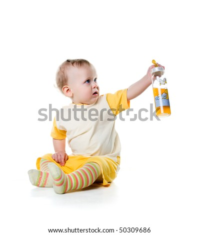 Little boy with the bottle of fruit juice - stock photo