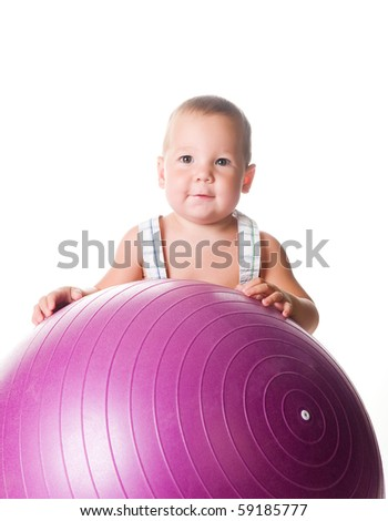 Little boy with the fitness ball on white background - stock photo