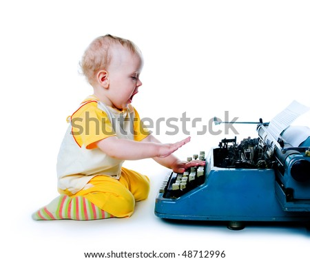 Little boy with the old typewriter on white background - stock photo