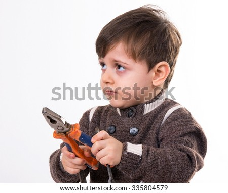 little boy with the pliers on white