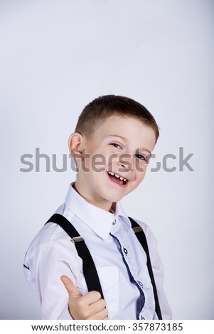 Little boy with thumb up gesture isolated over white background.Portrait of confident happy little boy showing thumbs up gesture wearing costume  isolated over white - stock photo