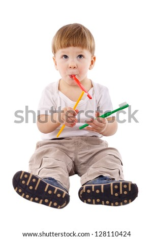 Little boy with toothbrush in the mouth, isolated on white