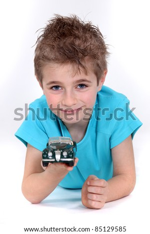 Little boy with toy car - stock photo