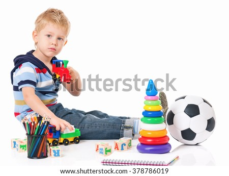 Little boy with toys isolated on white background