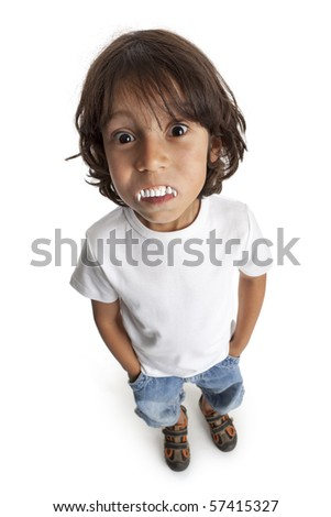 Little boy with vampires teeth on white background