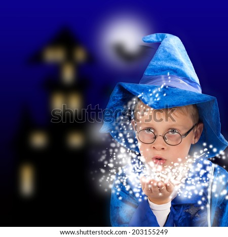 little boy with wizard costume in halloween night - stock photo