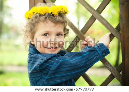 little boy with wreath - stock photo