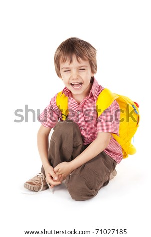 Little boy with yellow school bag - stock photo