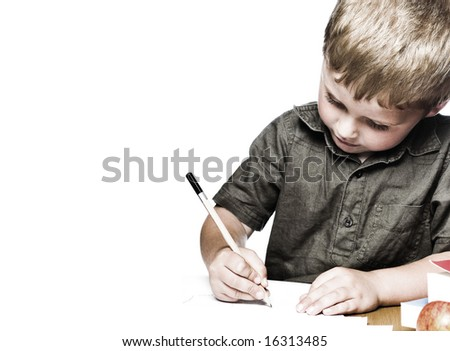 Little boy working hard at school. - stock photo