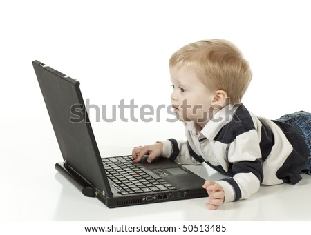 Little Boy Working with his Computer - stock photo