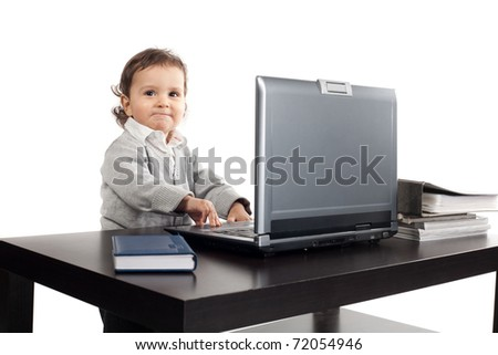 little boy works on laptop isolated on white - stock photo