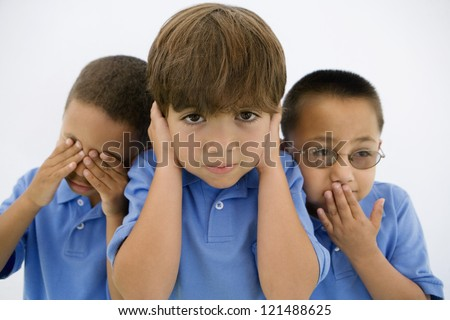 "Little boys depicting the phrase ""See no evil, Hear no evil, Speak no evil"" - stock photo"