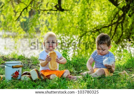 Little boys drinking milk on picnic