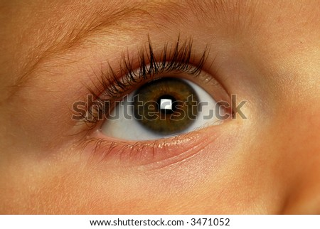 little boys eye looking up - stock photo